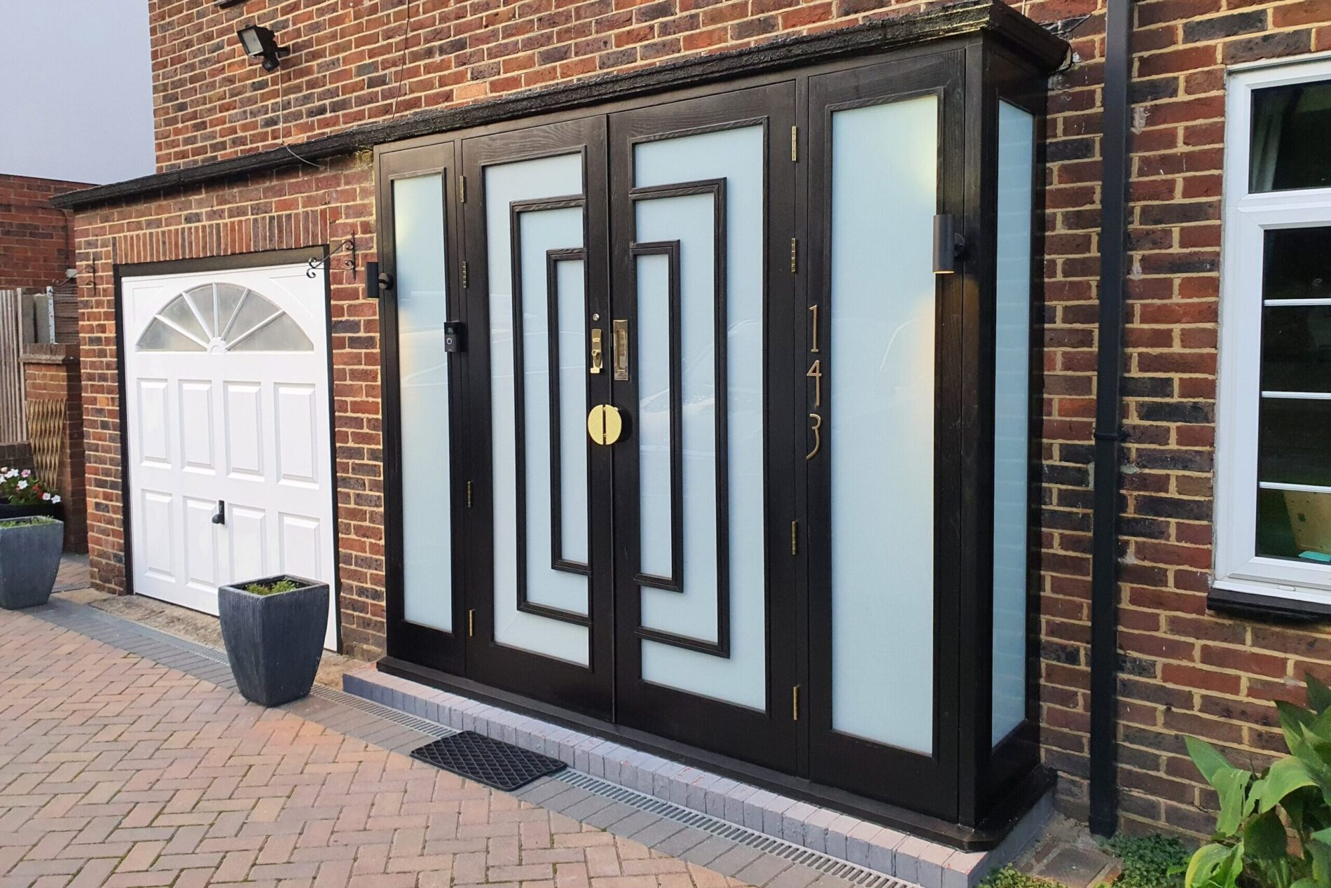 Hard wood entrance doors painted im black